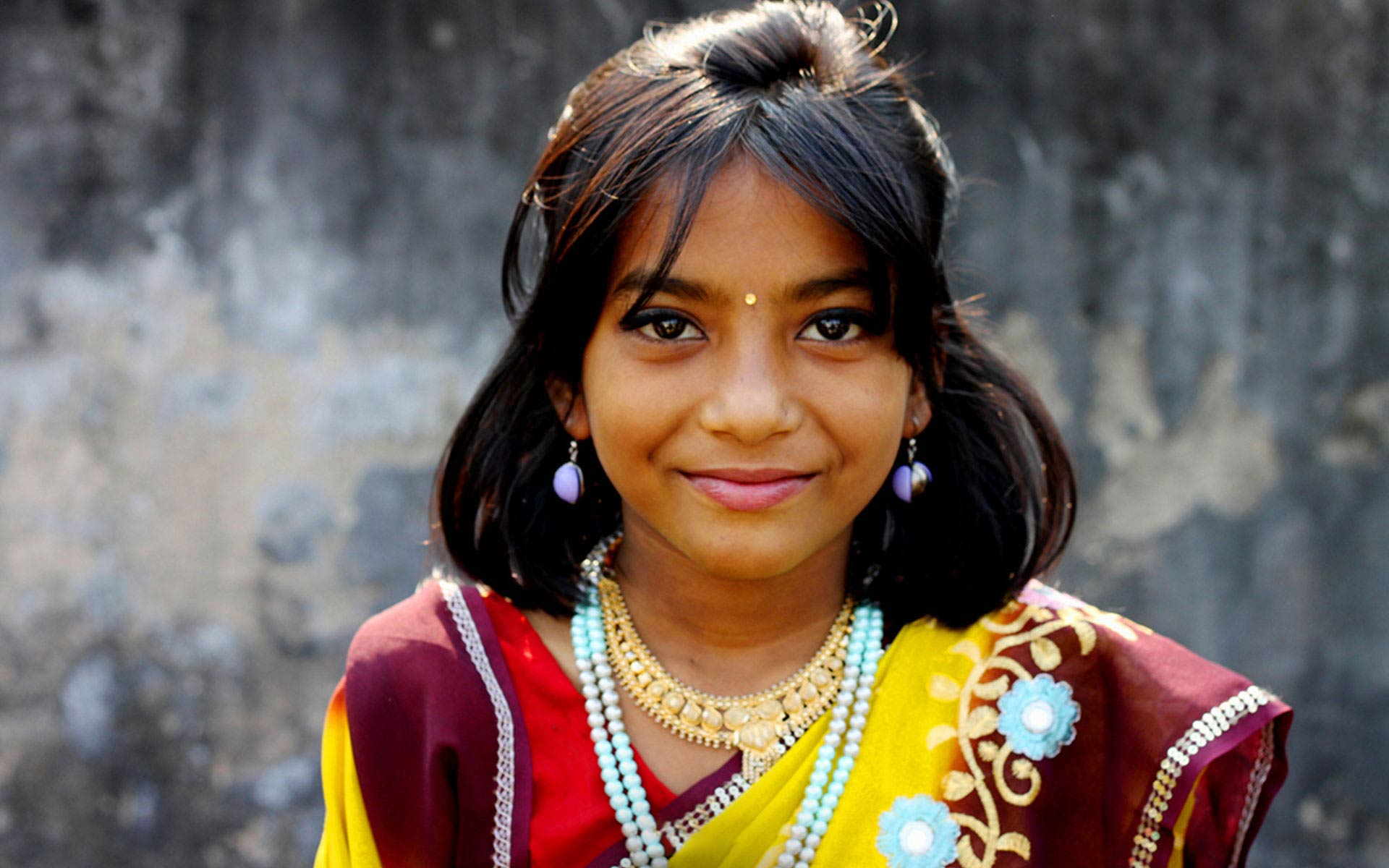 A girl from India dressed up in traditoinal clothing