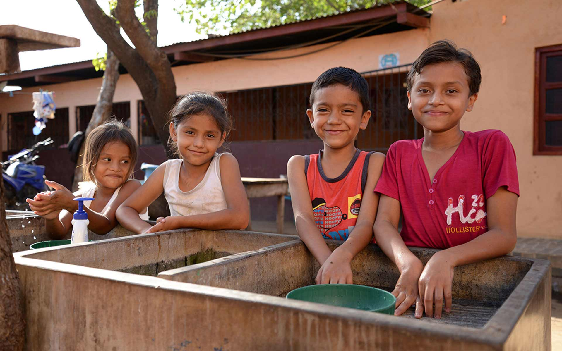 Children in Nicaragua wash their hands with clean water