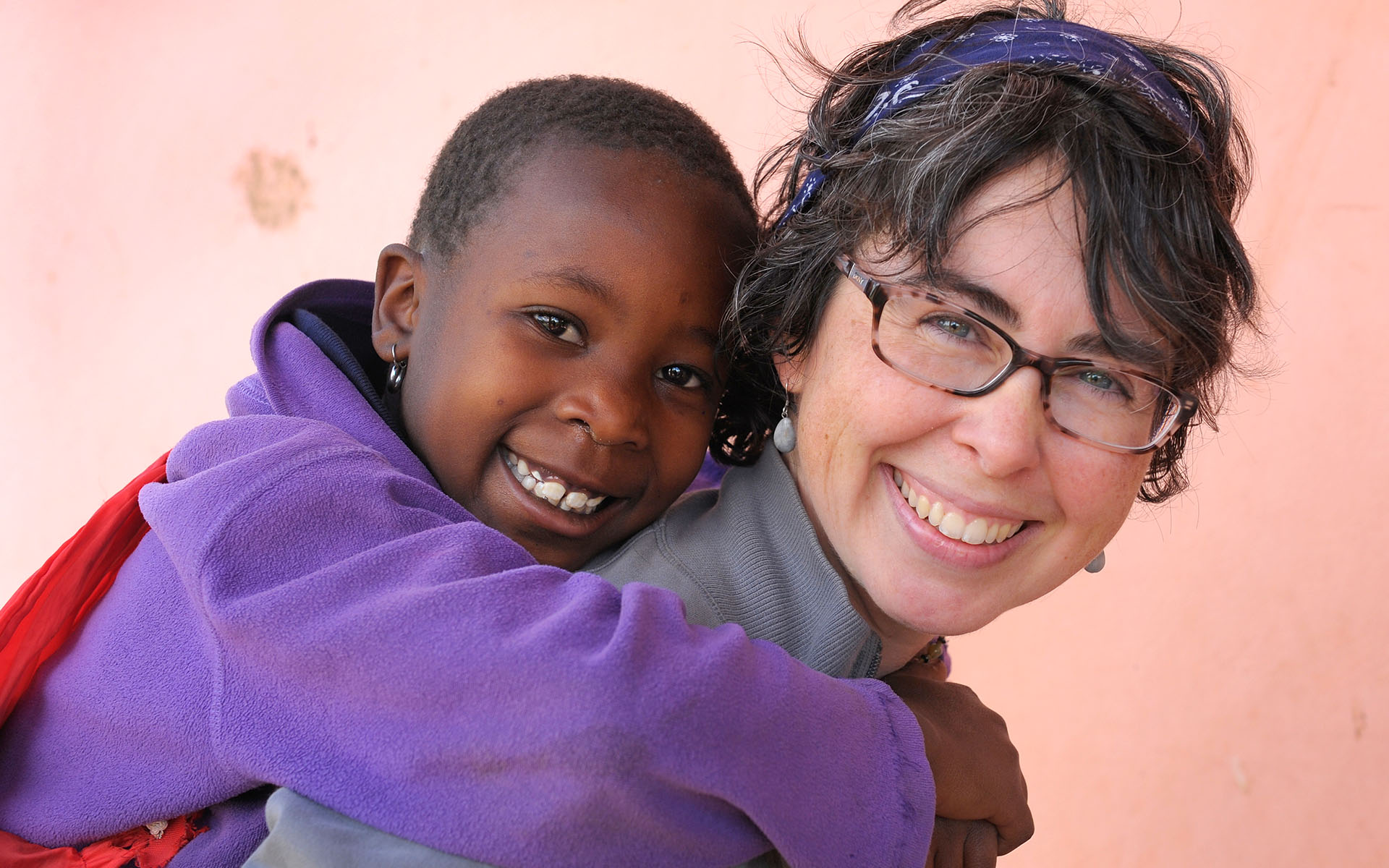 Sponsor Pammi Simone spends time with a sponsored child in Tanzania