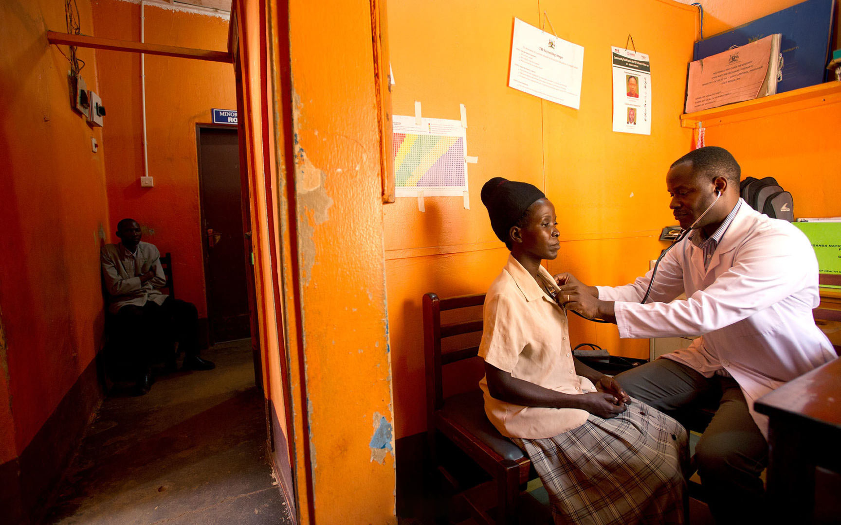 A mother with HIV having a checkup from a doctor in Uganda