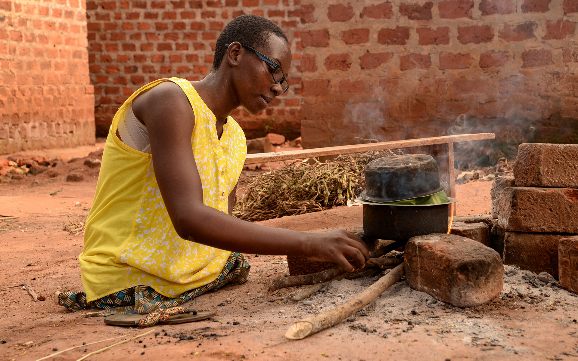 Grace prepares a meal on her outdoor stove