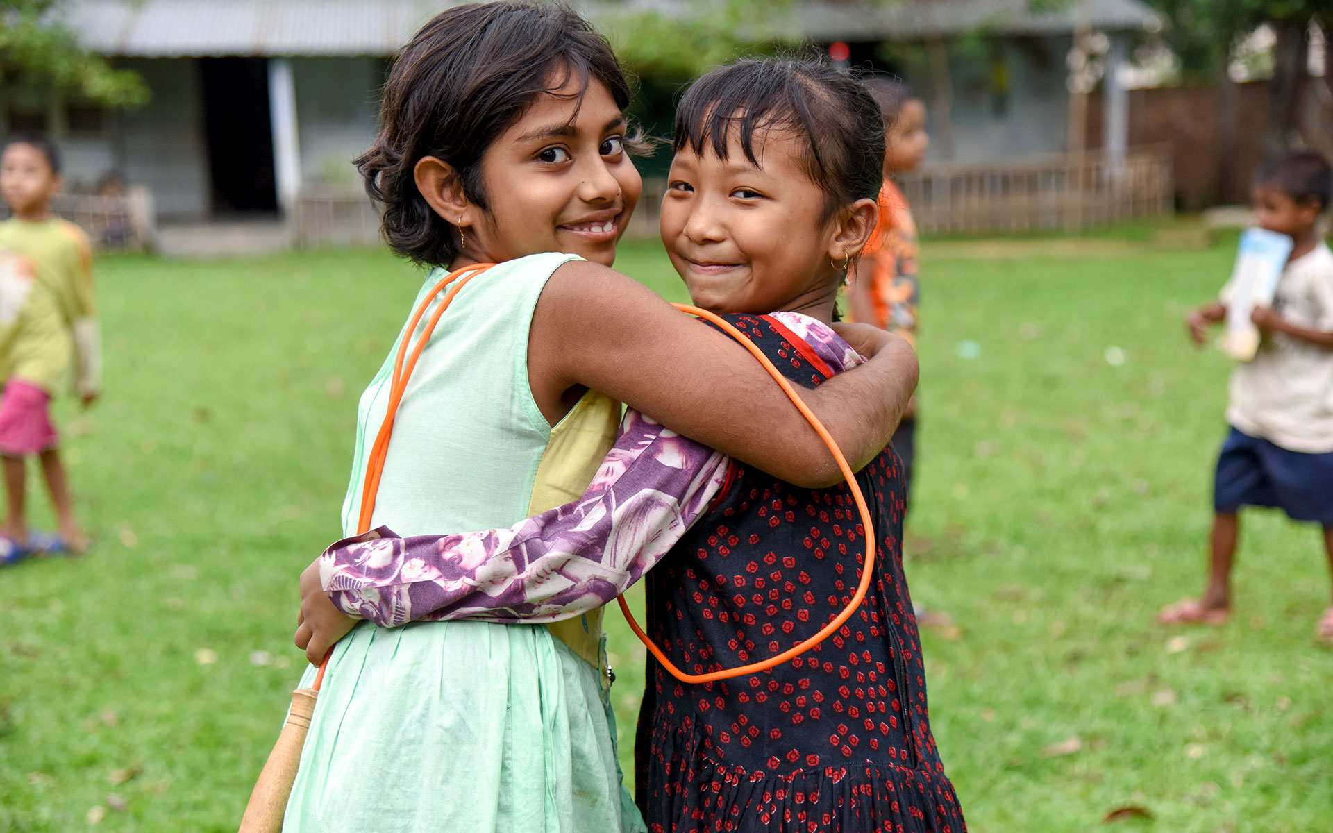 Sejoti hugs her friend at a Compassion center