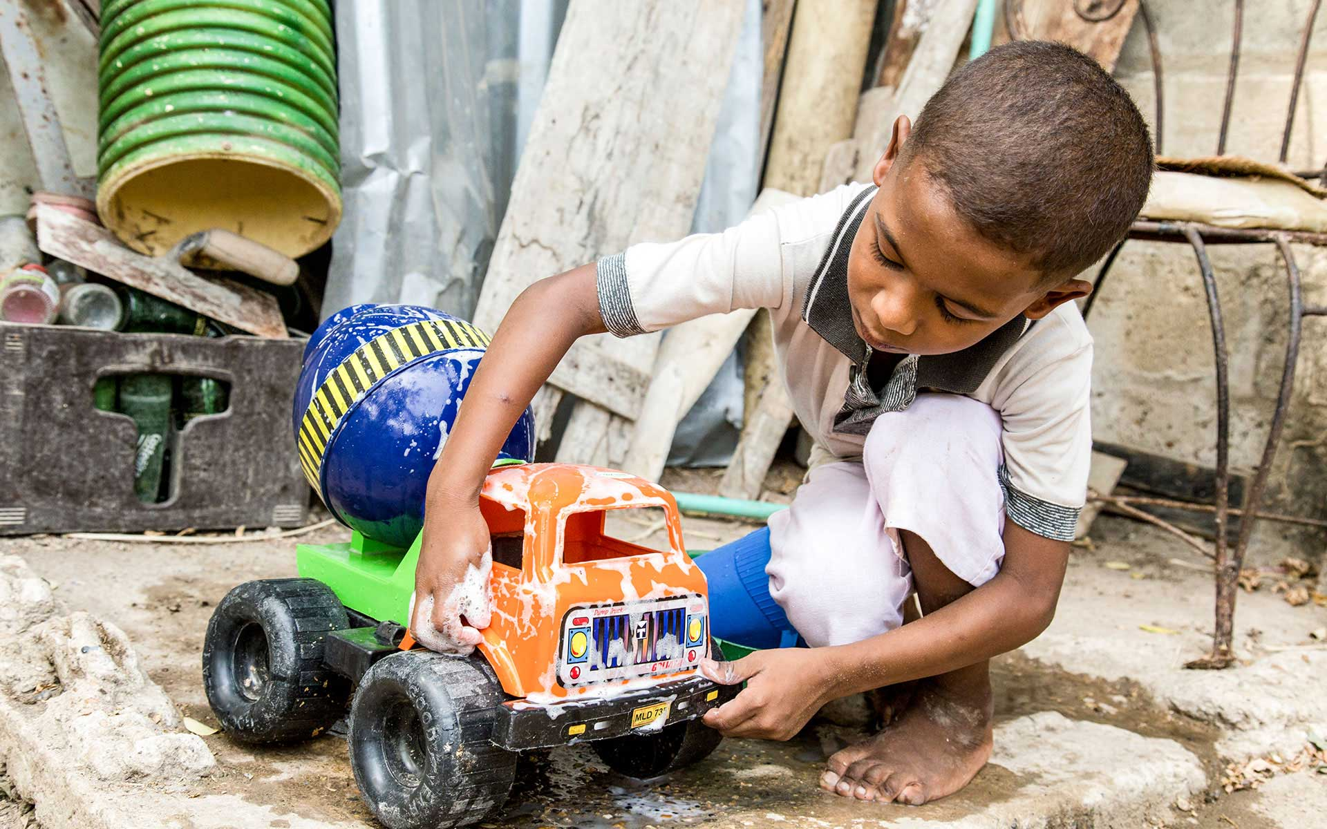 A sponsored boy in Columbia plays with the truck he received for Christmas