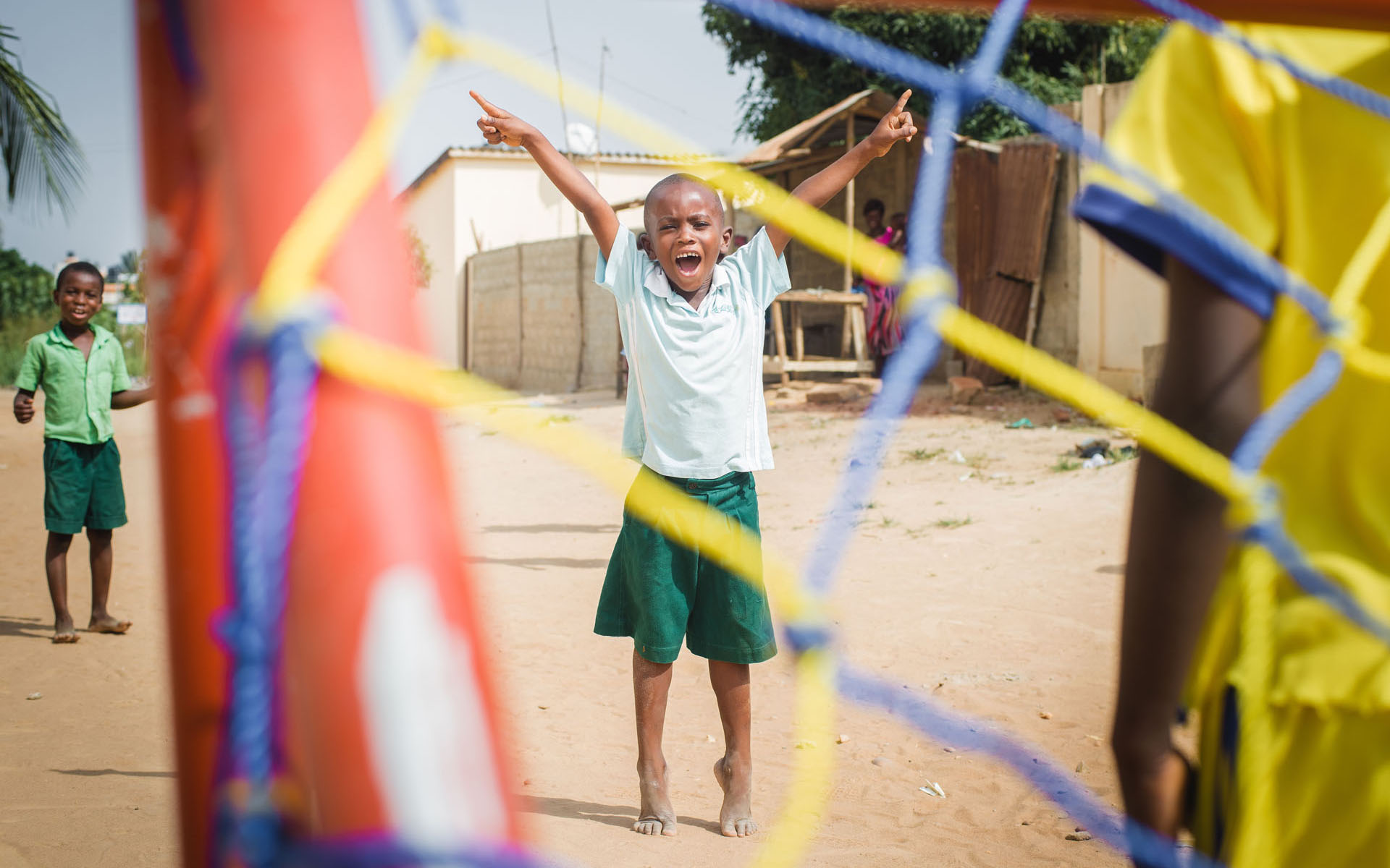 Segnon plays soccer at his Compassion center in Togo.