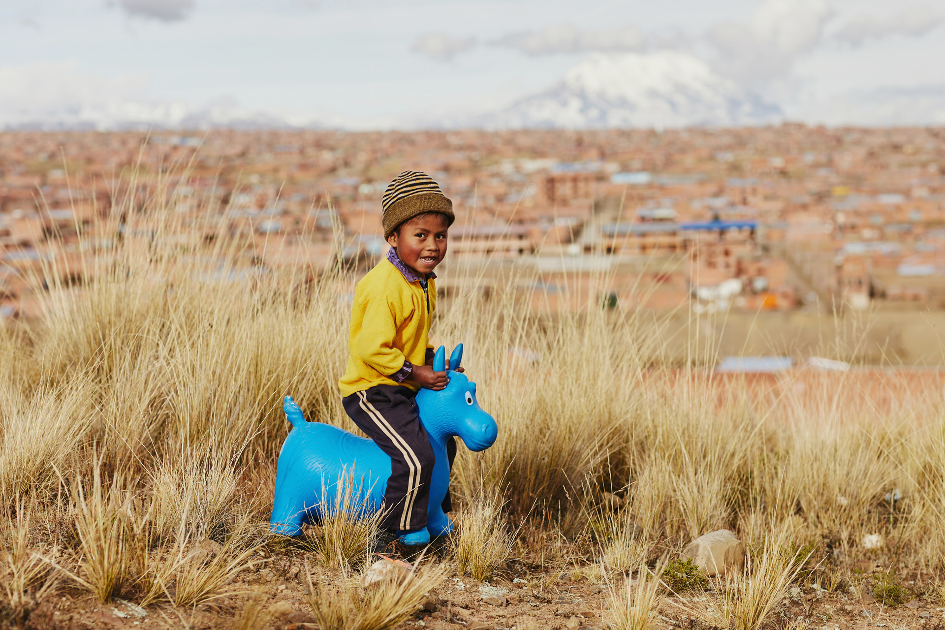 Clever, a 7-year-old Bolivian boy in Compassion's program plays with a gift from his sponsor