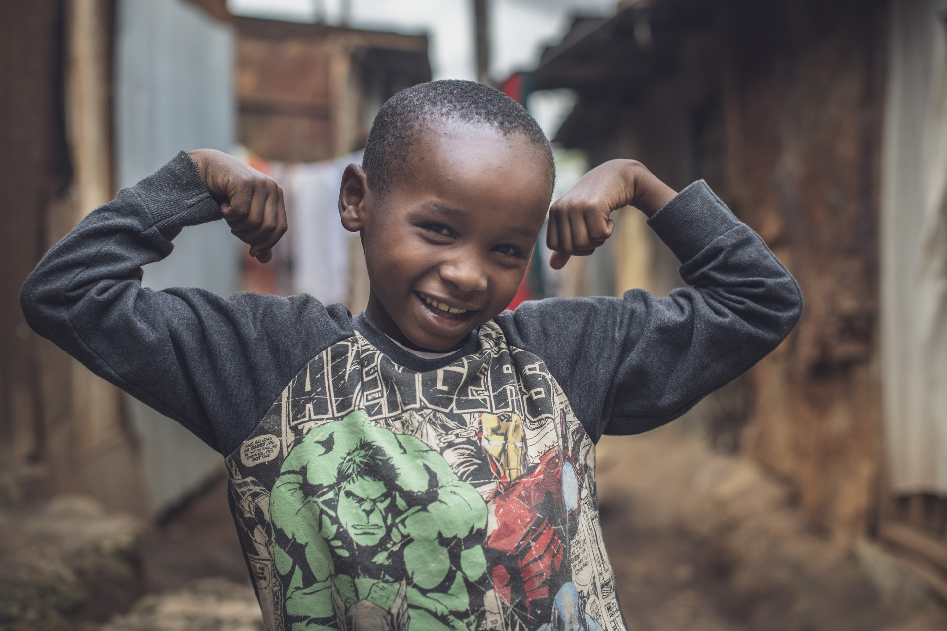 Denzel, 8, flexes his muscles to show how strong he's growing