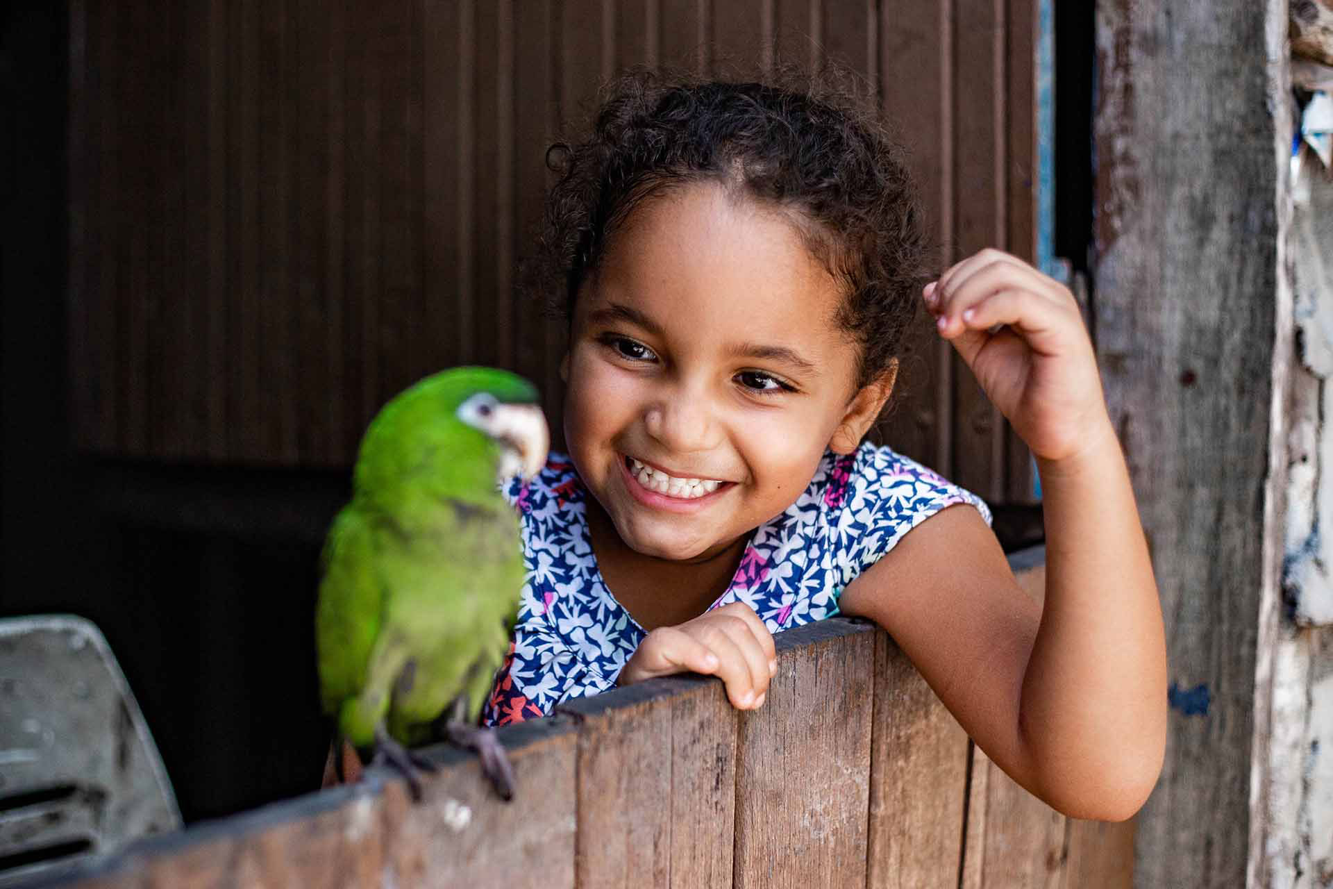 Maisa, a joyful 4-year-old in Brazil watches a bird
