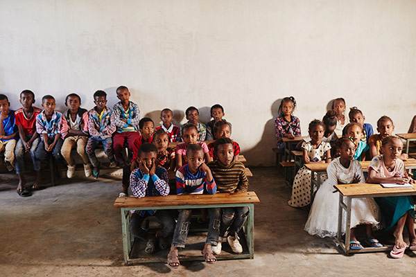 A group of children sitting at their desks in a classroom in Ethiopia