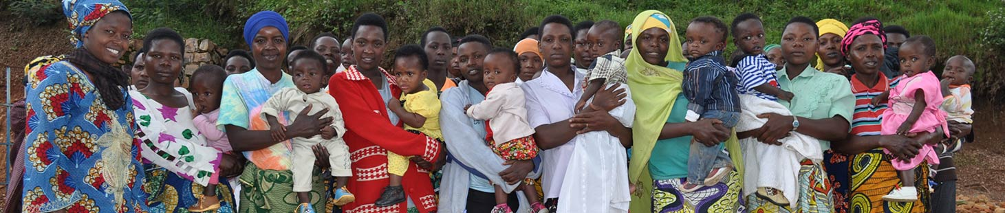 An a group of Rwandan women holding babies in their arms