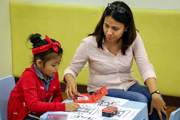 Layla volunteers to tutor children at her local Compassion Center