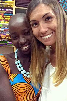 Allegra standing with one of her sponsored children from Uganda