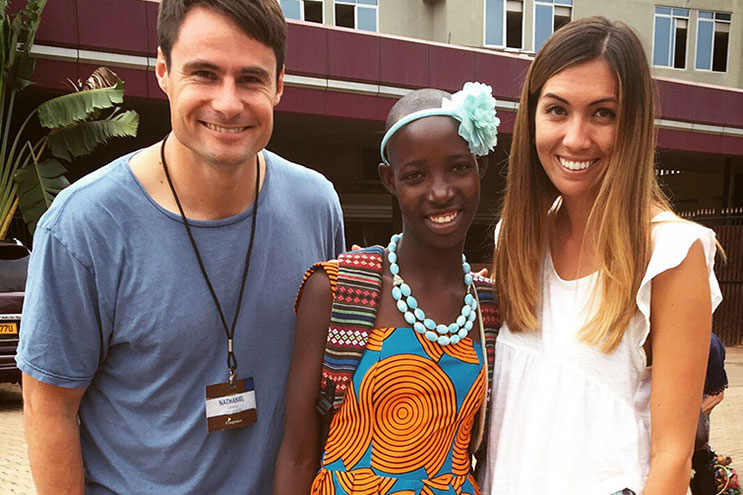 Allegra standing with her sponsored child from Uganda