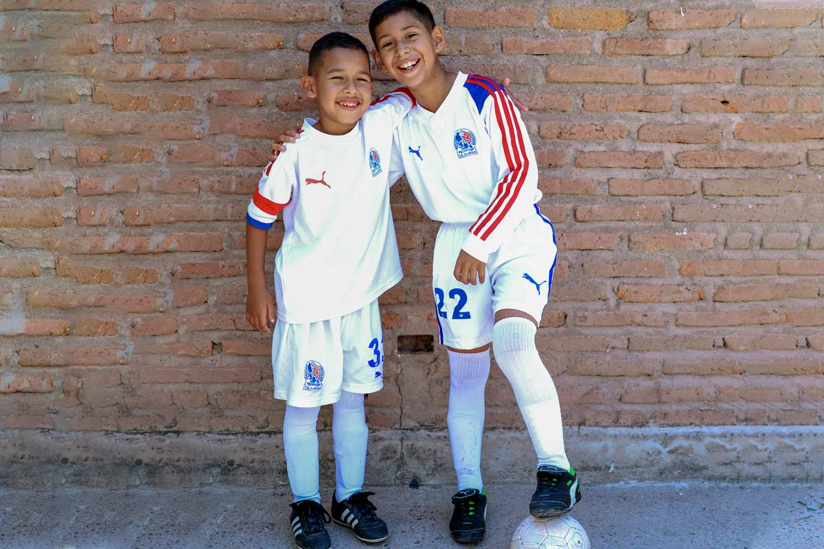 Two boys from Honduras wearing their soccer uniforms