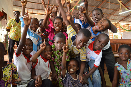 A large group of smiling Togolese children