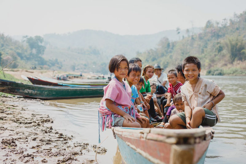 A group of children in a boat