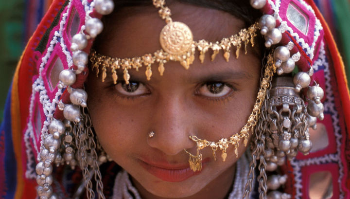 An Indian girl dressed in her ceremonial dress