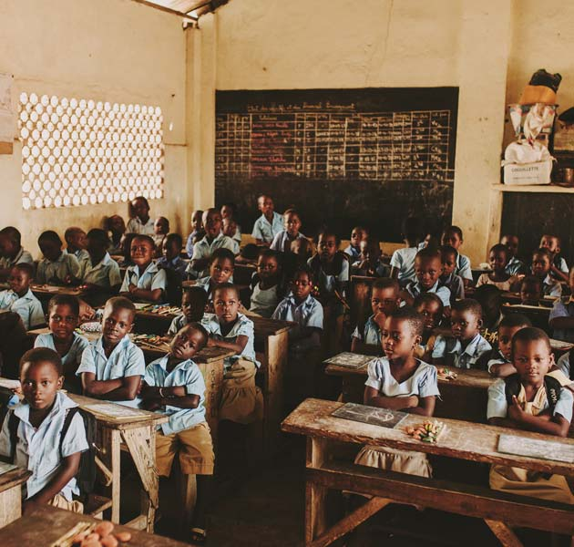 Children filling up a classroom in Togo
