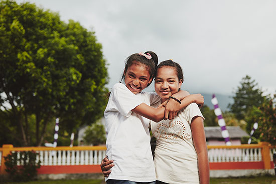 Two girls embracing and showing compassion