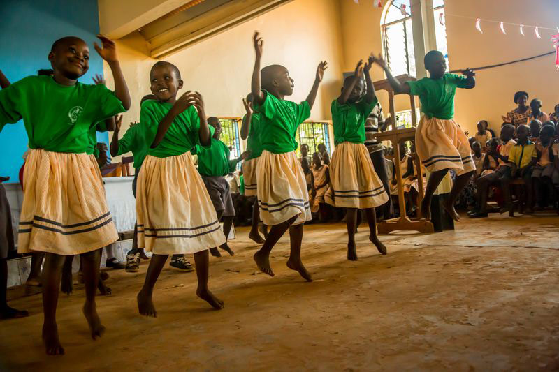 A group of girls dance at their child development center