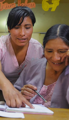A Bolivian mother gets guidance from Alicia in class