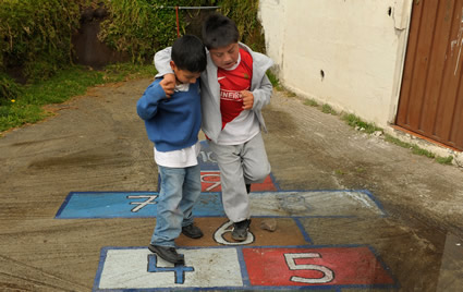 two boys playing hopscotch