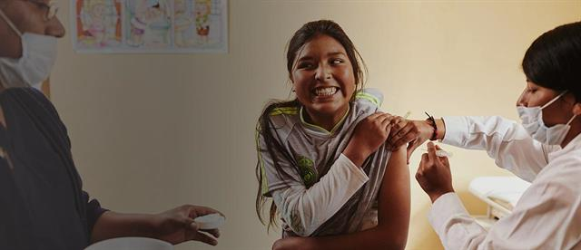 A girl receiving a vaccination