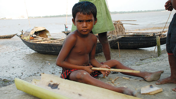 Bangladesh Boy Sitting on a Beach