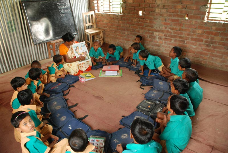 Bangladesh Children Sitting in a Circle at School