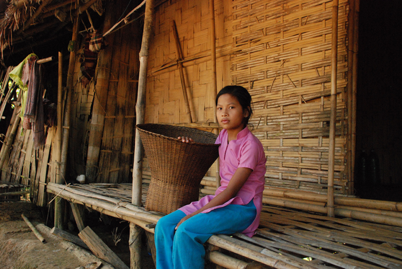 Bangladesh Girl Sitting on Porch
