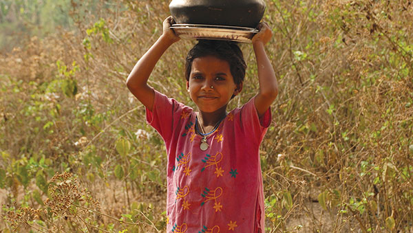 Bangladesh Girl With a Pot On Her Head