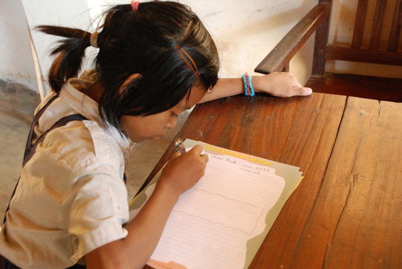 Bangladesh Girl Writing Sponsor Letter