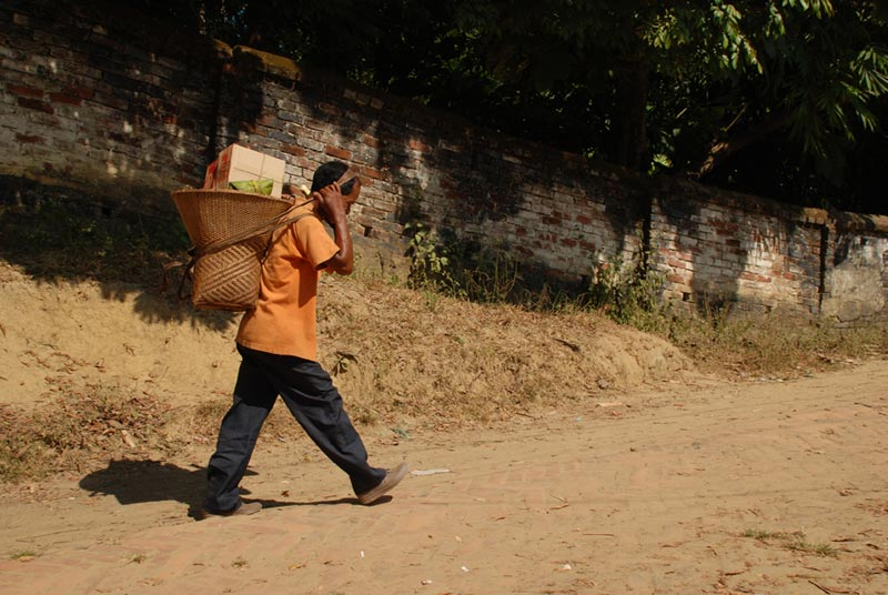 Bangladesh Man Carrying Basket on Road