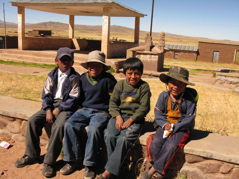 Bolivia boys sitting on wall