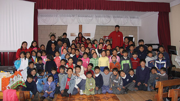 Bolivia children at front of church