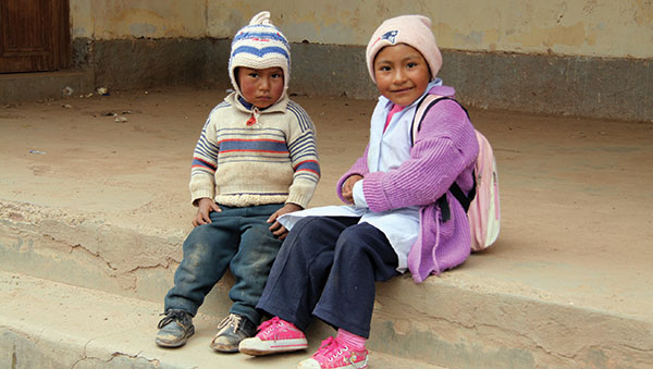 Bolivia children sitting on step