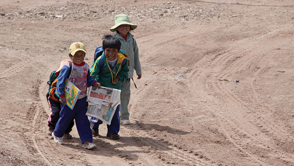 Bolivia children walking on road