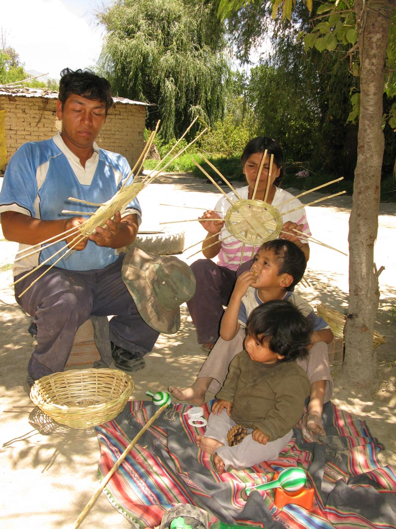 Bolivia family weaving baskets