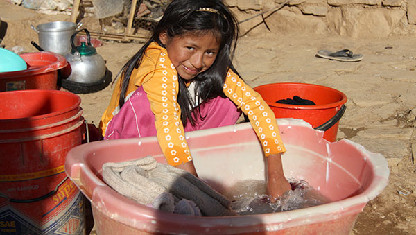 Bolivia girl washing clothes