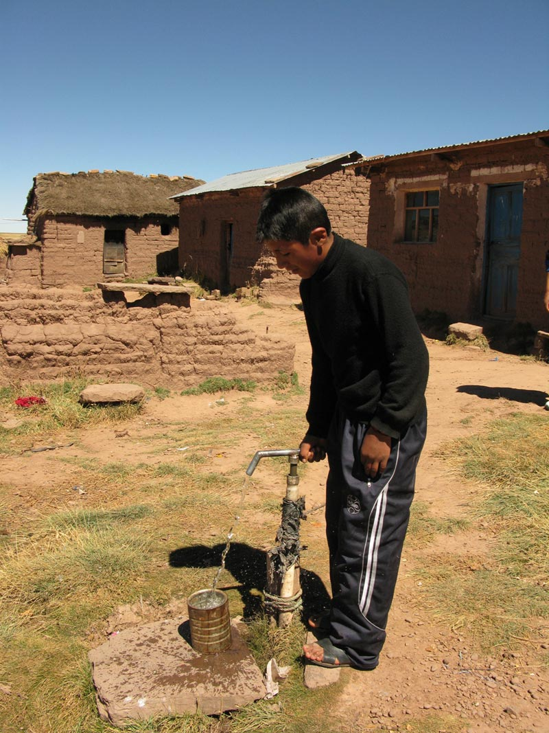 Bolivia man pumping water