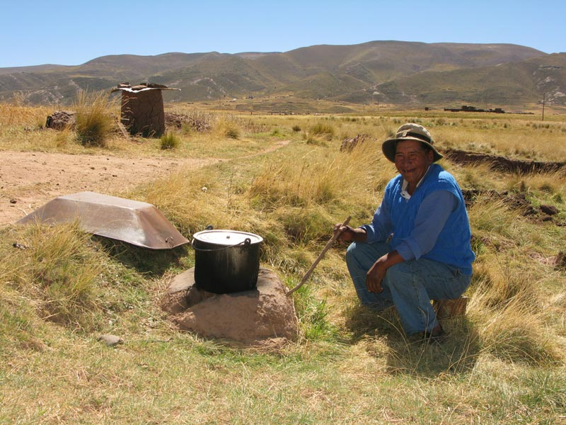 Bolivia man with cooking pot