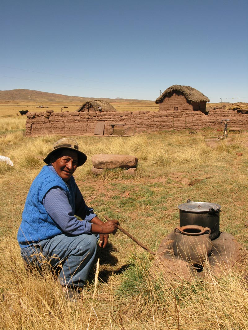 Bolivia man with cooking pots
