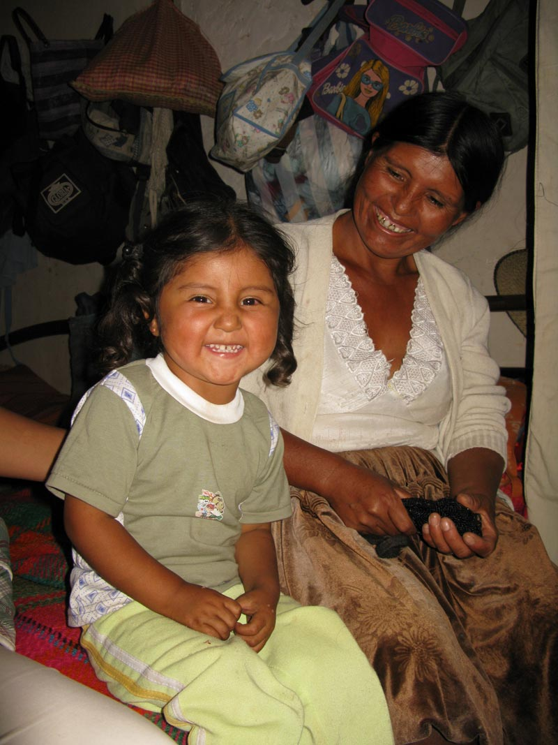 Bolivia mother and girl smiling
