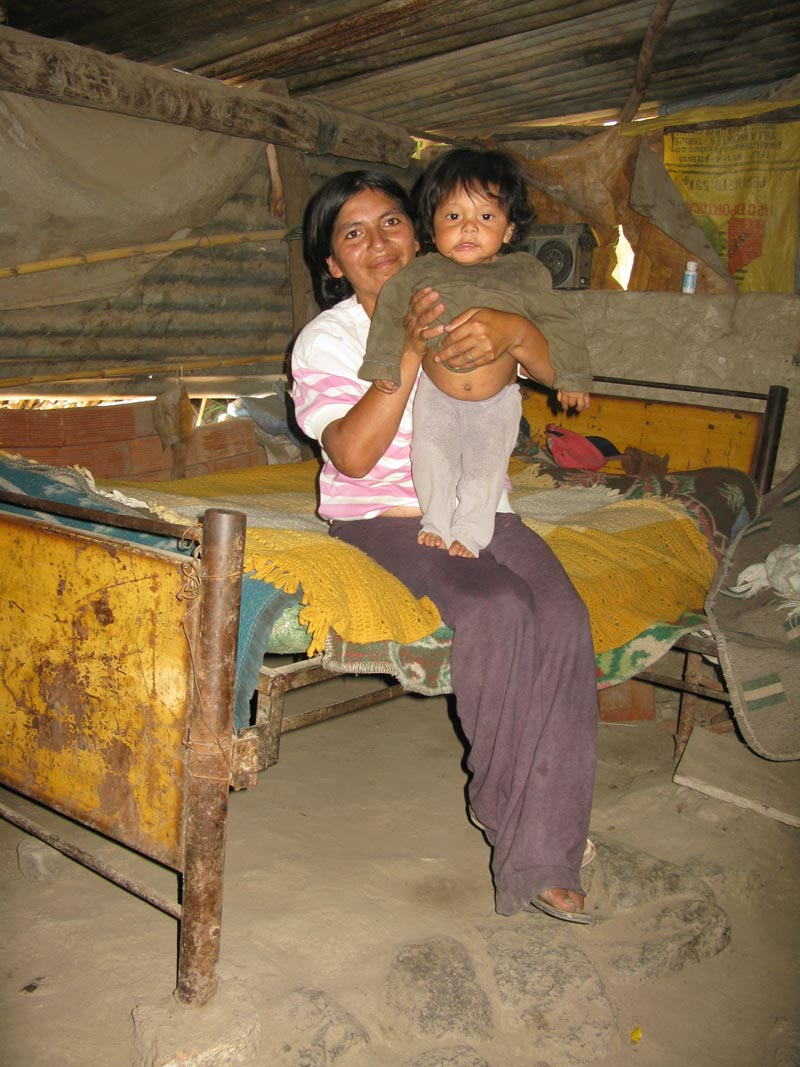 Bolivia mother and son on bed