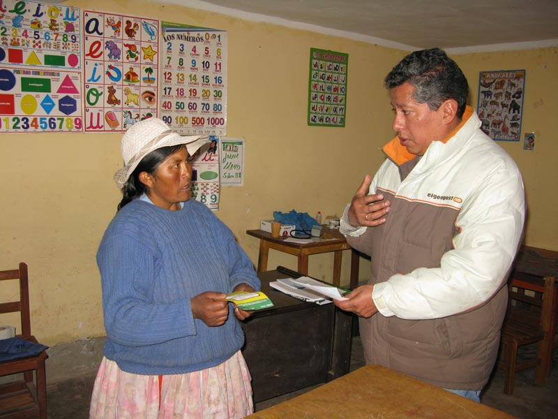 Bolivia woman and man in child development center