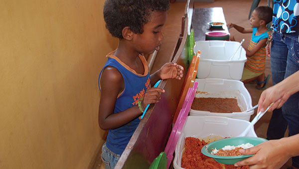Brazil Boy Getting Plate of Food