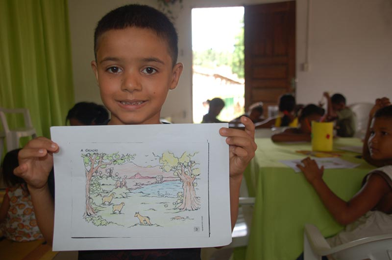 Brazil Boy Holding Drawing