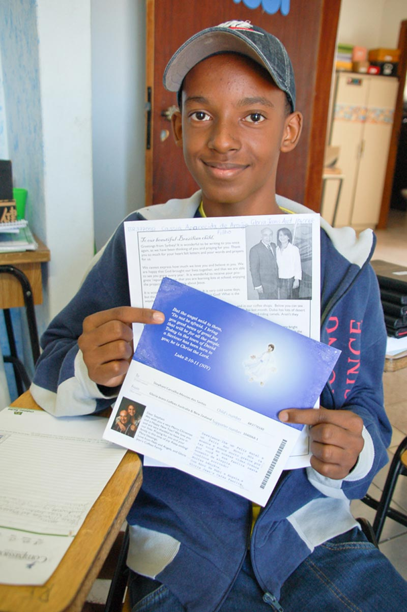 Brazil Boy with Letter from Sponsor