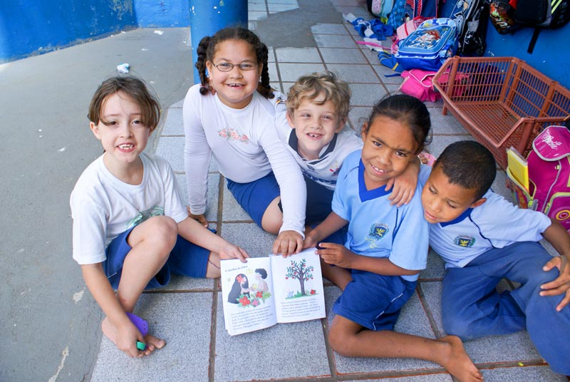 Brazil Children Holding Storybook