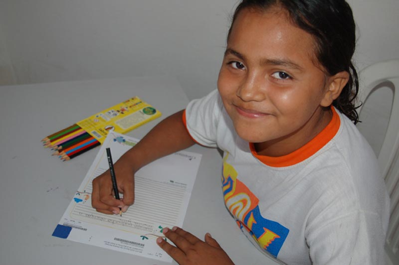 Brazil Girl Writing Sponsor Letter