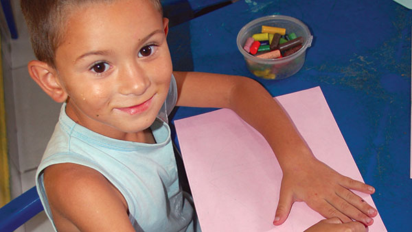 Brazil Smiling Boy with Crayons
